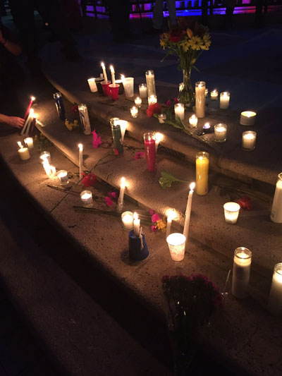 "<div class=""meta image-caption""><div class=""origin-logo origin-image none""><span>none</span></div><span class=""caption-text"">Mourners leave candles and flowers at a memorial in West Palm Beach, Florida. (Megan Bosinger/Twitter)</span></div>"