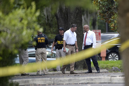 "<div class=""meta image-caption""><div class=""origin-logo origin-image none""><span>none</span></div><span class=""caption-text"">Police officials investigate the lot behind the Pulse nightclub. (AP)</span></div>"