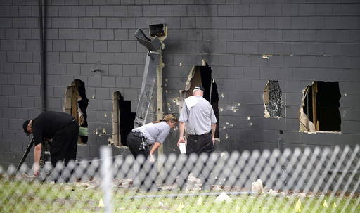 "<div class=""meta image-caption""><div class=""origin-logo origin-image none""><span>none</span></div><span class=""caption-text"">Police officials investigate the back of the Pulse nightclub (AP)</span></div>"