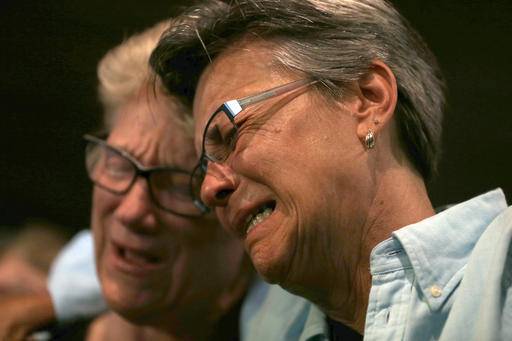 <div class='meta'><div class='origin-logo' data-origin='none'></div><span class='caption-text' data-credit='AP'>Judy Rettig, right, and Karen Castelloes cry during a prayer vigil Joy Metropolitan Community Church.</span></div>