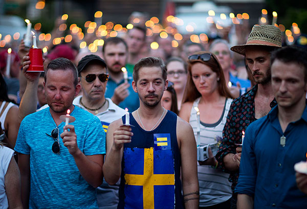 <div class='meta'><div class='origin-logo' data-origin='none'></div><span class='caption-text' data-credit='David Goldman/AP Photo'>Mourners observe a moment of silence during a vigil for victims of a fatal shooting at an Orlando nightclub, Sunday, June 12, 2016, in Atlanta.</span></div>
