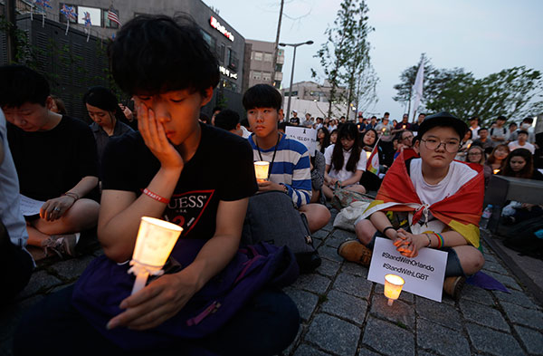 <div class='meta'><div class='origin-logo' data-origin='none'></div><span class='caption-text' data-credit='Ahn Young-joon/AP Photo'>People hold candles during a vigil in Seoul, South Korea on Monday, June 13 to pay tribute to the victims of the Orlando shooting.</span></div>
