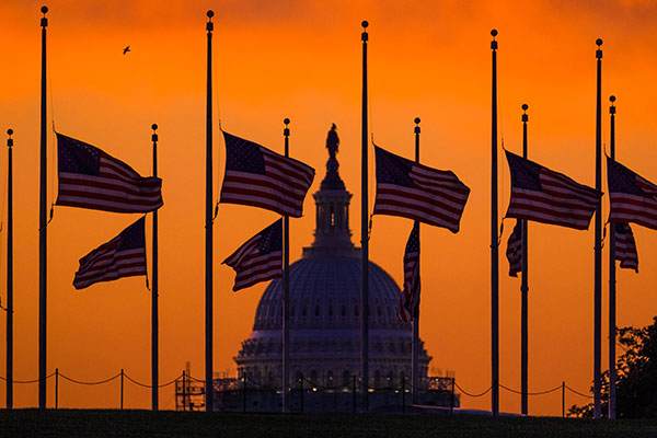 <div class='meta'><div class='origin-logo' data-origin='none'></div><span class='caption-text' data-credit='J. David Ake./AP Photo'>Flags fly at half-staff around the Washington Monument at daybreak in Washington with the US Capitol in the background Monday, June 13, 2016.</span></div>
