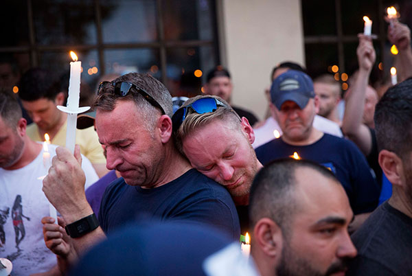 <div class='meta'><div class='origin-logo' data-origin='none'></div><span class='caption-text' data-credit='David Goldman/AP Photo'>Paul Cox, right, leans on the shoulder of Brian Sullivan, as they observe a moment of silence during a vigil on Sunday, June 12 in Atlanta.</span></div>