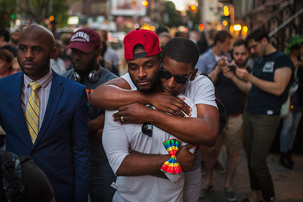 <div class='meta'><div class='origin-logo' data-origin='none'></div><span class='caption-text' data-credit='Andres Kudacki/AP Photo'>A couple embraces as people gather in front of a makeshift memorial in New York to remember the victims of a mass shooting in Orlando, Fla.</span></div>