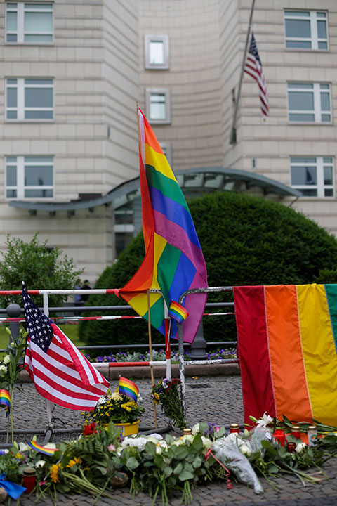 <div class='meta'><div class='origin-logo' data-origin='none'></div><span class='caption-text' data-credit='Markus Schreiber/AP Photo'>Rainbow flags and flowers placed in front of the United States embassy during a vigil in Berlin, Germany, Monday, June 13, 2016.</span></div>