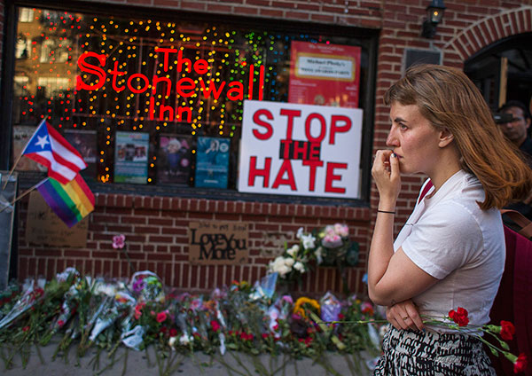 <div class='meta'><div class='origin-logo' data-origin='none'></div><span class='caption-text' data-credit='Andres Kudacki/AP Photo'>A woman cries and holds flowers in front of a makeshift memorial to remember the victims of a mass shooting in Orlando, Fla., in New York.</span></div>