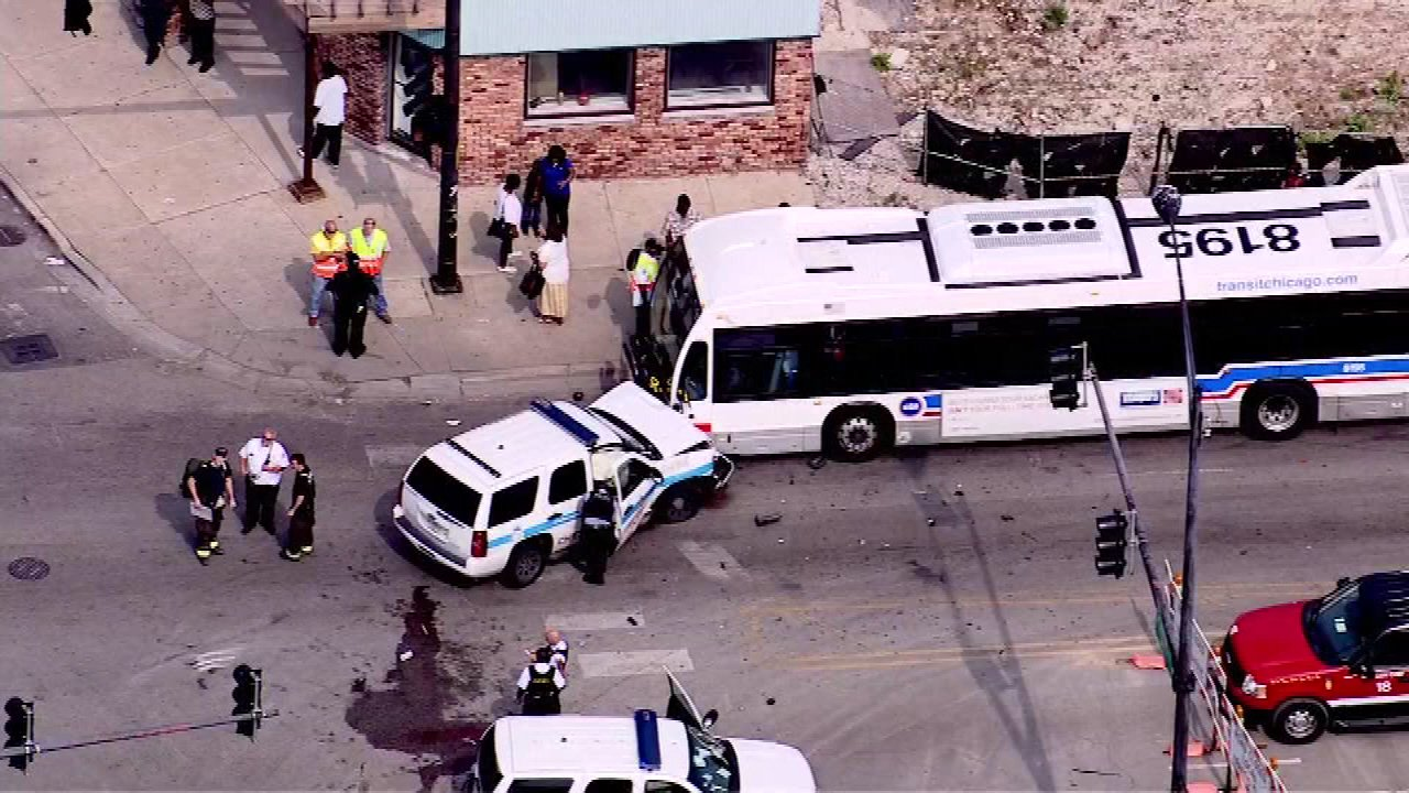 Eight people were injured in a crash involving a Chicago police squad car, a CTA bus and another vehicle on Chicago's West Side Monday afternoon.