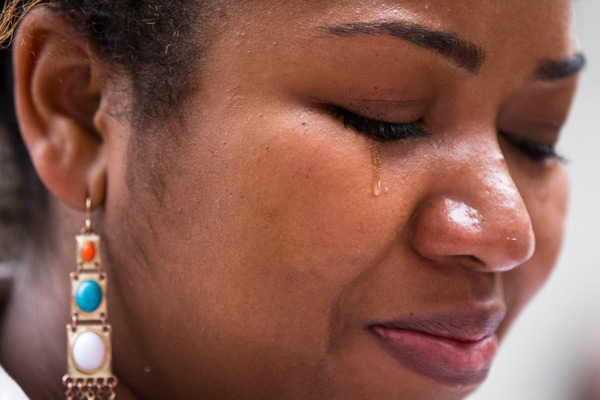 """<div class=""""meta image-caption""""><div class=""""origin-logo origin-image ap""""><span>AP</span></div><span class=""""caption-text"""">A tear falls on a young person's cheek during a vigil in memory of the victims of the Orlando, Fla., mass shooting, Monday, June 13, 2016, at City Hall in Philadelphia. (AP Photo/Matt Rourke)</span></div>"""