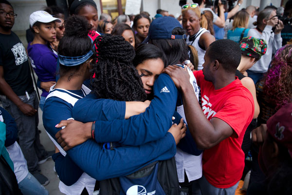 """<div class=""""meta image-caption""""><div class=""""origin-logo origin-image ap""""><span>AP</span></div><span class=""""caption-text"""">Mourners from West Catholic Preparatory High School embrace during a vigil in memory of the victims of the Orlando, Fla., mass shooting. (AP Photo/Matt Rourke)</span></div>"""