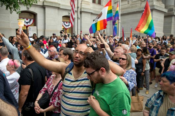"""<div class=""""meta image-caption""""><div class=""""origin-logo origin-image ap""""><span>AP</span></div><span class=""""caption-text"""">People gather for a vigil in memory of the victims of the Orlando, Fla., worst mass shooting in modern U.S. history, Monday, June 13,, June 13, 2016, at City Hall in Philadelphia. (AP Photo/Matt Rourke)</span></div>"""