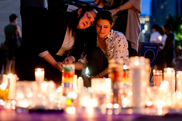 """<div class=""""meta image-caption""""><div class=""""origin-logo origin-image ap""""><span>AP</span></div><span class=""""caption-text"""">People gather for a vigil in memory of the victims of the Orlando, Fla., mass shooting, Monday, June 13, 2016, at City Hall in Philadelphia. (AP Photo/Matt Rourke)</span></div>"""
