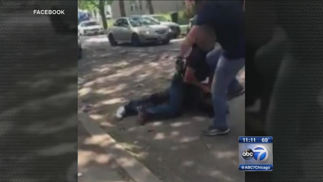 Officer appears to kick man in head