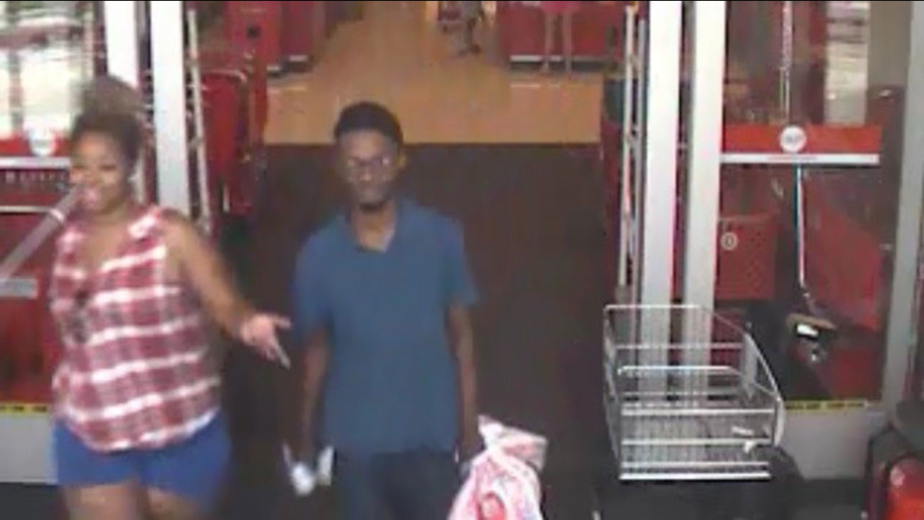 Authorities are trying to identify the pair seen on surveillance video during a shopping spree with stolen credit cards on May 25th.