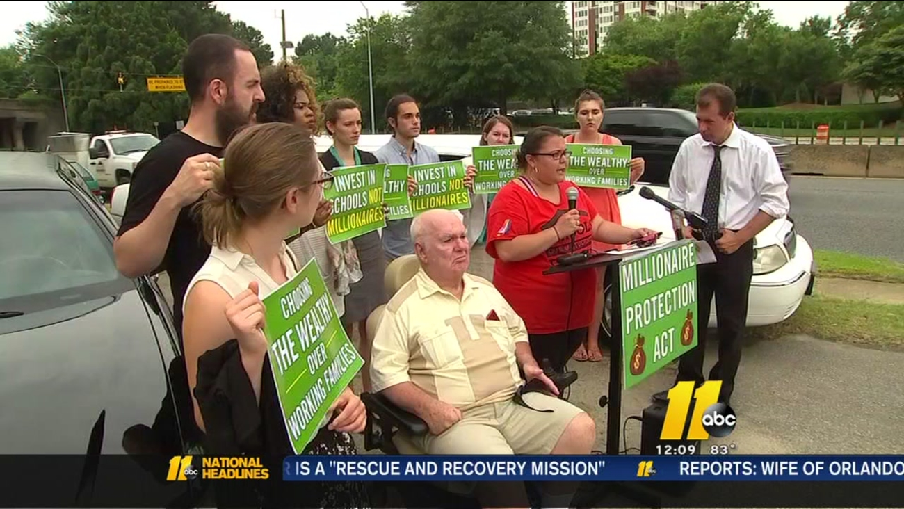 Group protests as Senate gears up for debate over lower income tax cap