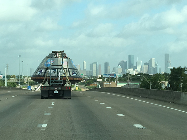 """<div class=""""meta image-caption""""><div class=""""origin-logo origin-image none""""><span>none</span></div><span class=""""caption-text"""">Approaching downtown #Houston. Post your sightings to #SpotOrion</span></div>"""