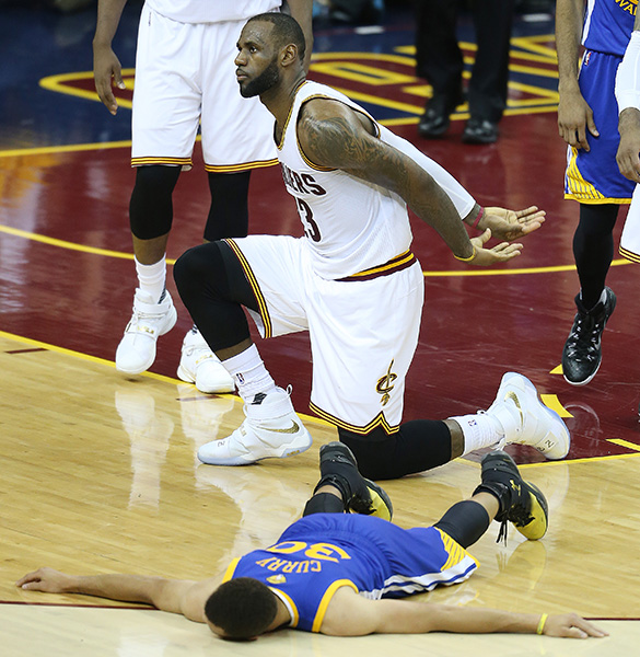 Cleveland Cavaliers forward LeBron James against Golden State Warriors guard Stephen Curry during the first half of Game 6 of basketball's NBA Finals.