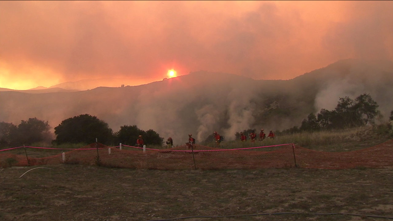 Firefighters work to chop dry brush that could fuel the already massive Sherpa Fire in northern Santa Barbara County on Friday, June 17, 2016.