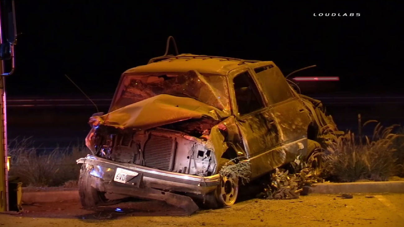 A mangled Chevrolet Tahoe sits in a parking lot after the driver lost control, causing it to flip over and crash in Wildomar on Saturday, June 18, 2016.
