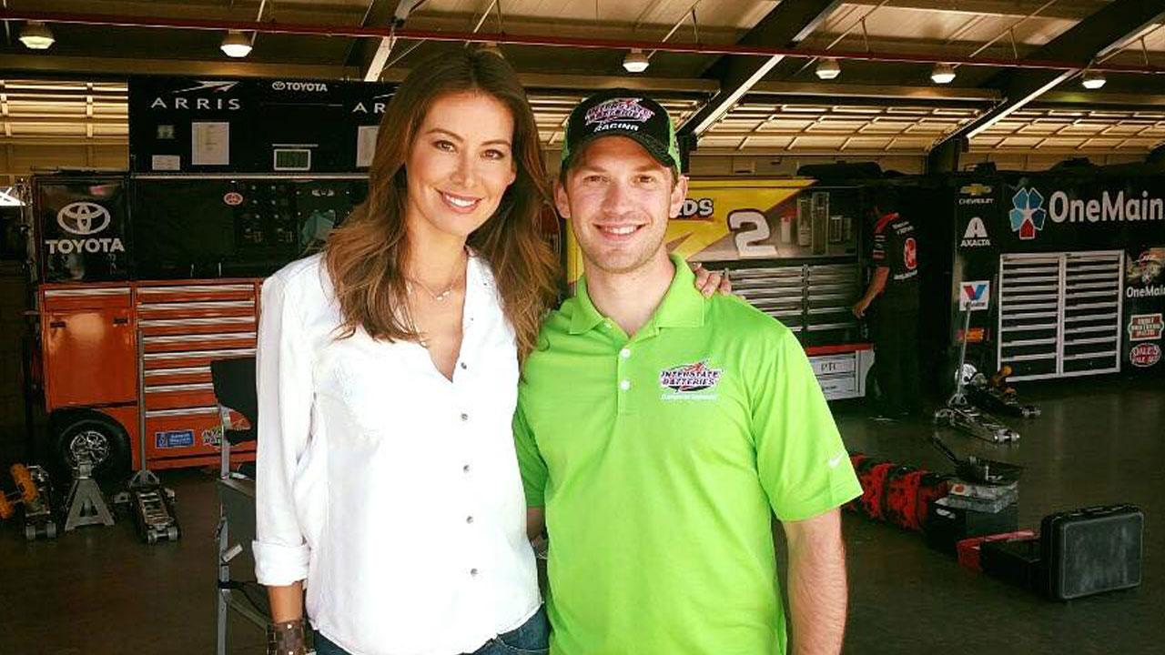 Patricia Lopez smiles with Mexican-born Nascar driver Daniel Suarez.