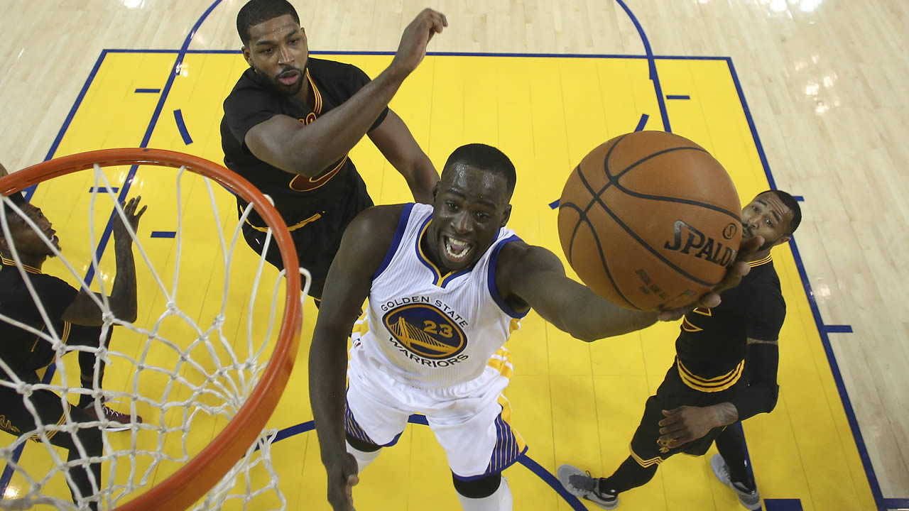 Golden State Warriors forward Draymond Green (23) reacts after scoring in the NBA Finals in Oakland, Calif., Sunday, June 19, 2016.
