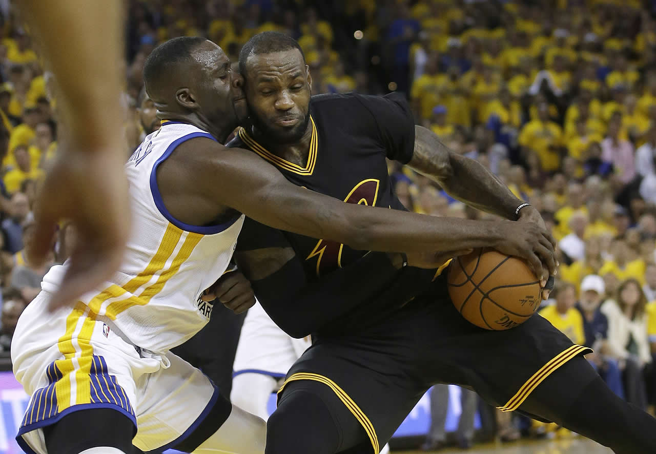 <div class='meta'><div class='origin-logo' data-origin='none'></div><span class='caption-text' data-credit='AP Photo/Marcio Jose Sanchez'>Cleveland Cavaliers forward LeBron James  is defended by Golden State Warriors Draymond Green in Game 7 of the NBA Finals in Oakland, Calif., Sunday, June 19, 2016.</span></div>