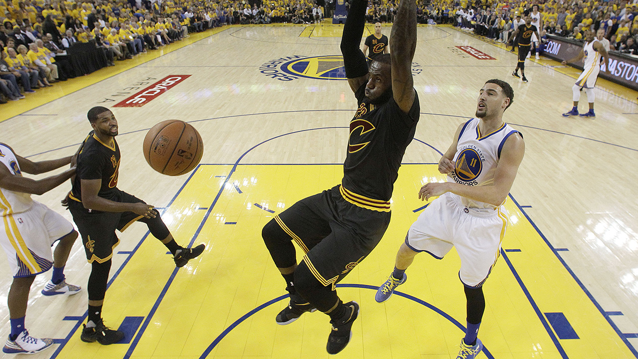 Cleveland Cavaliers forward LeBron James dunks against Golden State Warriors guard Klay Thompson (11) during the first half of Game 7 of basketball's NBA Finals in Oakland