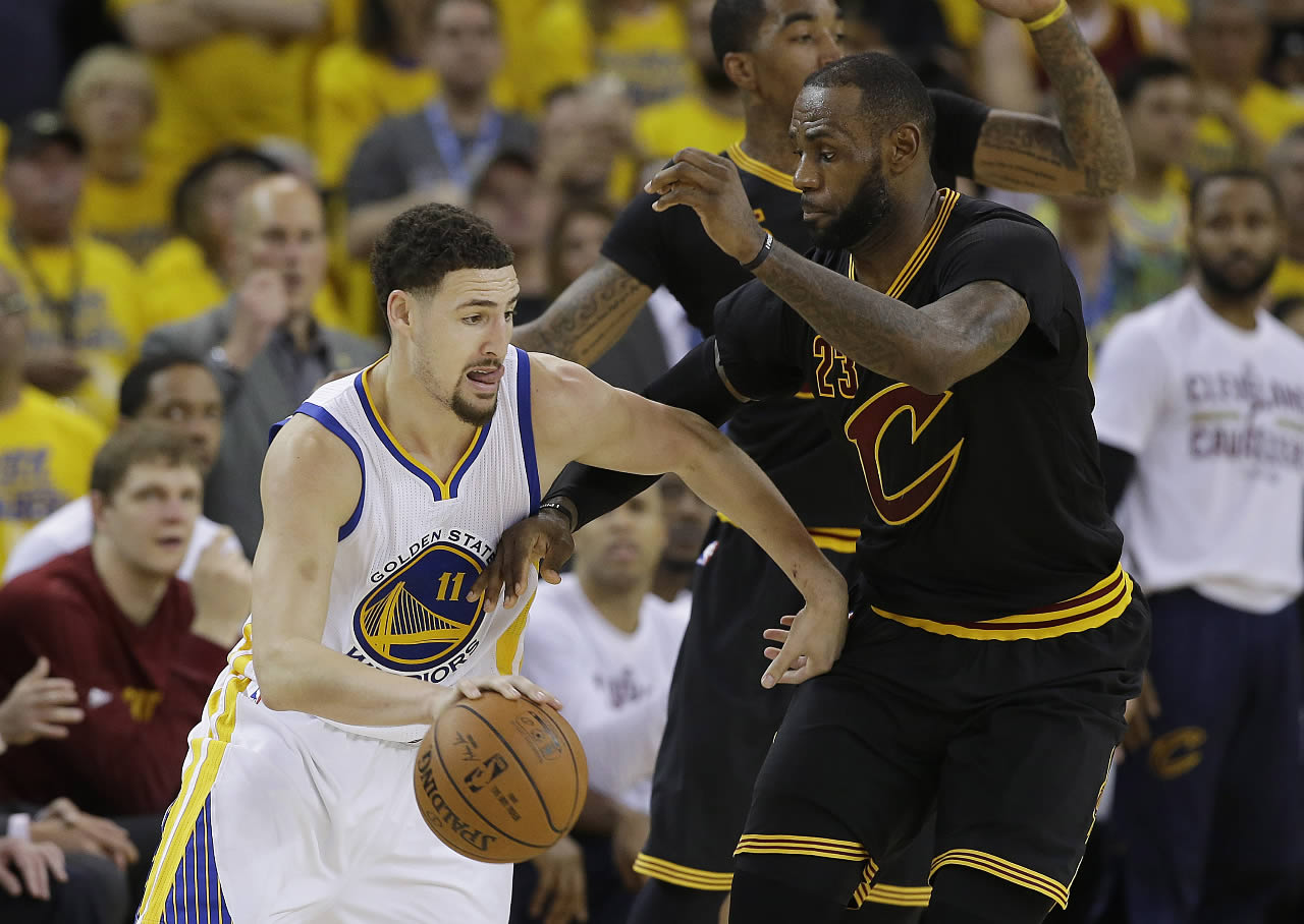"<div class=""meta image-caption""><div class=""origin-logo origin-image none""><span>none</span></div><span class=""caption-text"">Golden State Warriors guard Klay Thompson dribbles against Cleveland Cavaliers LeBron James during the Game 7 of basketball's NBA Finals in Oakland, Calif., Sunday, June 19, 2016. (AP Photo/Marcio Jose Sanchez)</span></div>"