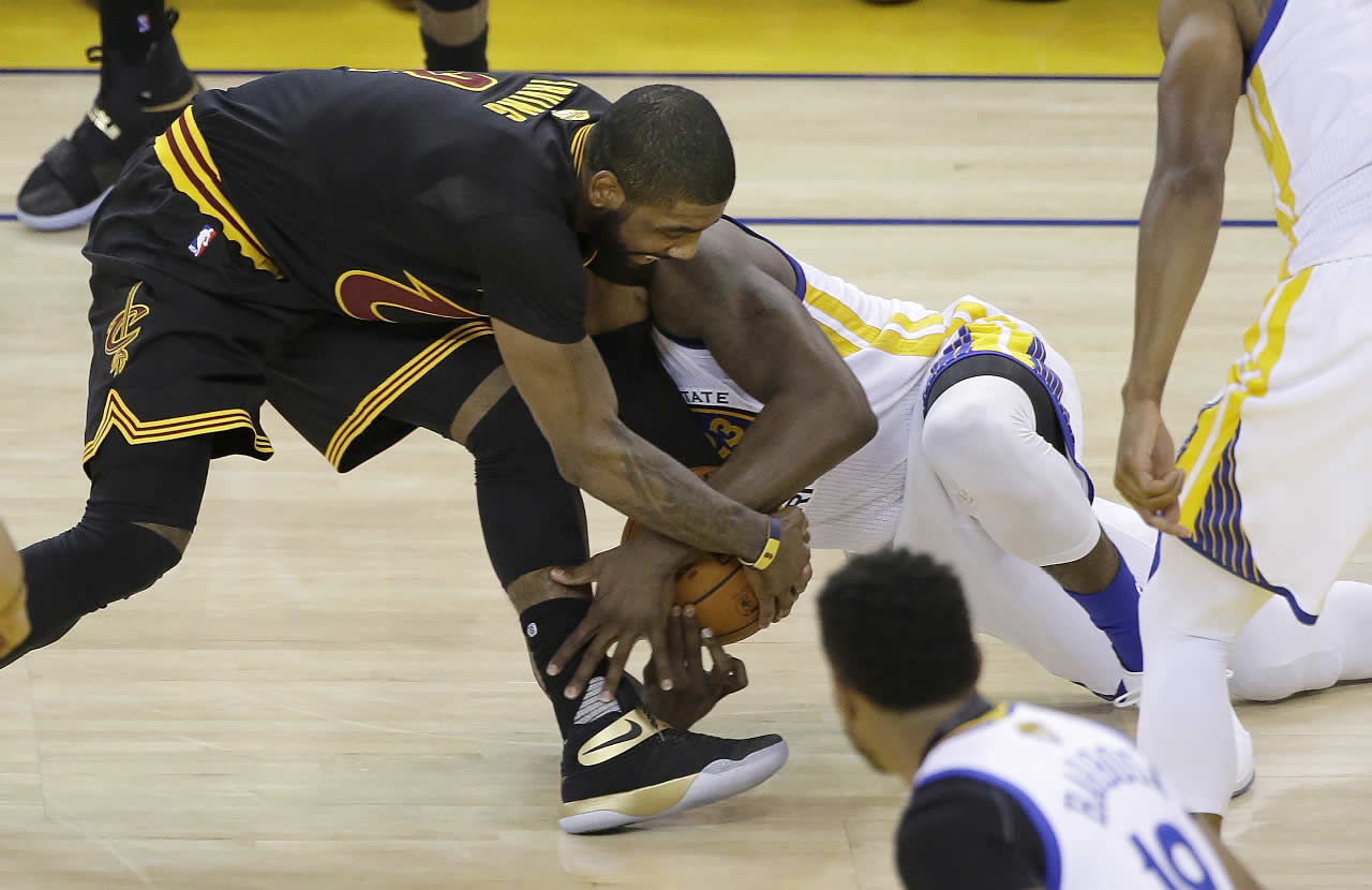 <div class='meta'><div class='origin-logo' data-origin='none'></div><span class='caption-text' data-credit='AP Photo/Eric Risberg'>Cleveland Cavaliers Kyrie Irving, left, reaches for a loose ball over Warriors forward Draymond Green in Game 7 of the NBA Finals in Oakland, Calif., Sunday, June 19, 2016.</span></div>