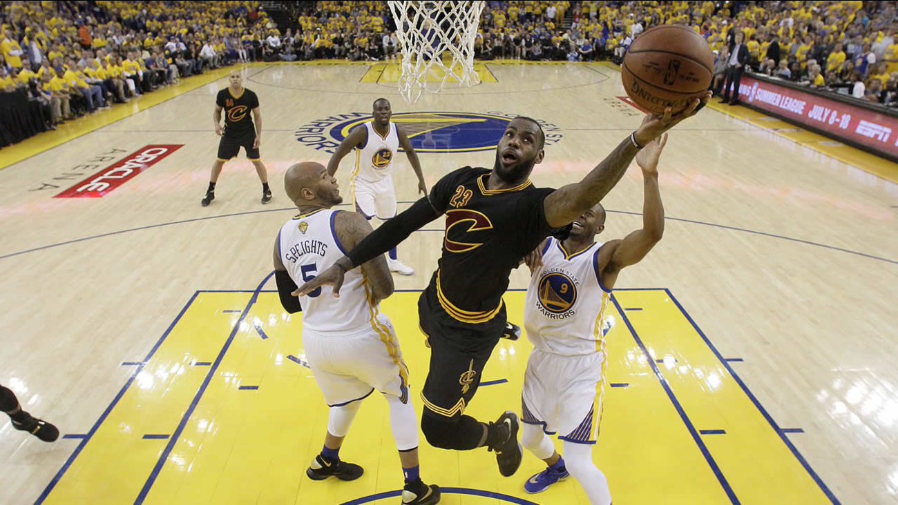 Cavaliers forward LeBron James shoots against the Warriors during Game 7 of basketball's NBA Finals in Oakland, Calif., Sunday, June 19, 2016. (AP Photo/Marcio Jose Sanchez, Pool)