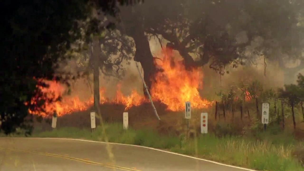 Crews battled a massive brush fire near the California and Mexican border on Sunday, June 19, 2016.
