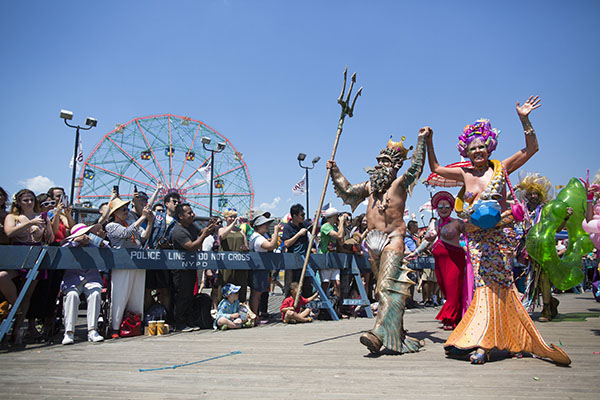 """<div class=""""meta image-caption""""><div class=""""origin-logo origin-image ap""""><span>AP</span></div><span class=""""caption-text"""">Participants march on the boardwalk during the 34th Annual Mermaid Parade, Saturday, June 18, 2016, in New York's Coney Island. (AP Photo/Mary Altaffer) (AP)</span></div>"""