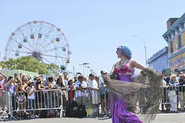 """<div class=""""meta image-caption""""><div class=""""origin-logo origin-image ap""""><span>AP</span></div><span class=""""caption-text"""">A participant marches on Surf Avenue past the Wonder Wheel during the 34th Annual Mermaid Parade, Saturday, June 18, 2016, in New York's Coney Island. (AP Photo/Mary Altaffer) (AP)</span></div>"""