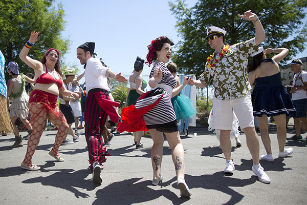"""<div class=""""meta image-caption""""><div class=""""origin-logo origin-image ap""""><span>AP</span></div><span class=""""caption-text"""">Participants rehearse their dance moves before marching in the 34th Annual Mermaid Parade, Saturday, June 18, 2016, in New York's Coney Island. (AP Photo/Mary Altaffer) (AP)</span></div>"""