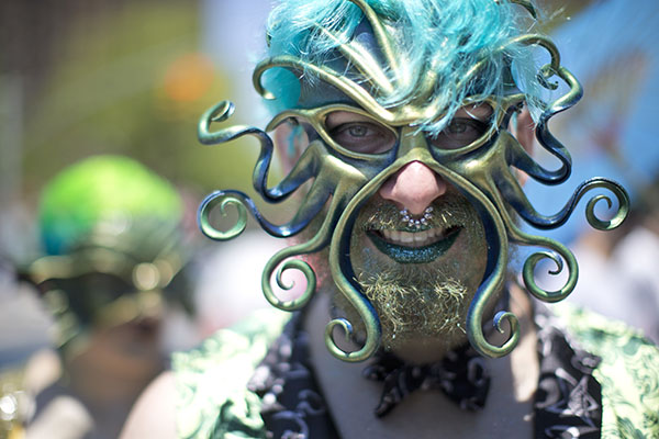 """<div class=""""meta image-caption""""><div class=""""origin-logo origin-image ap""""><span>AP</span></div><span class=""""caption-text"""">A participant poses for a photo in the staging area before marching in the 34th Annual Mermaid Parade, Saturday, June 18, 2016, in New York's Coney Island. (AP Photo/Mary Altaffer) (AP)</span></div>"""