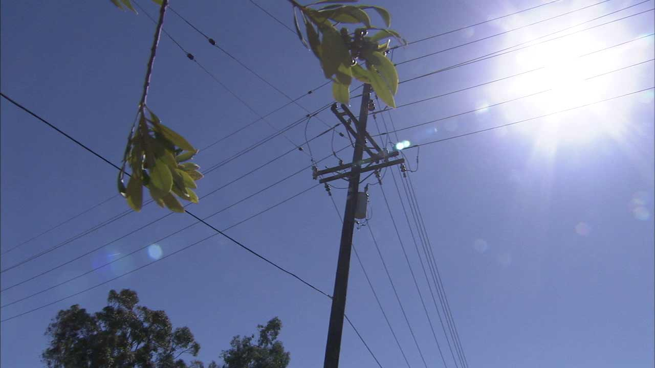 Power lines are seen on a hot day in Southern California.