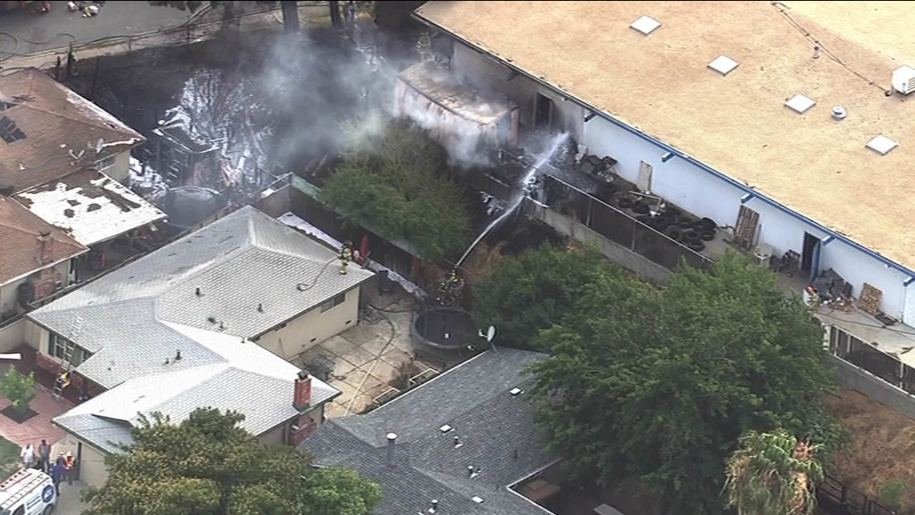 Crews are seen battling a fire at a home on Auto Center Drive in Antioch, Calif. on Monday, June 20, 2016.
