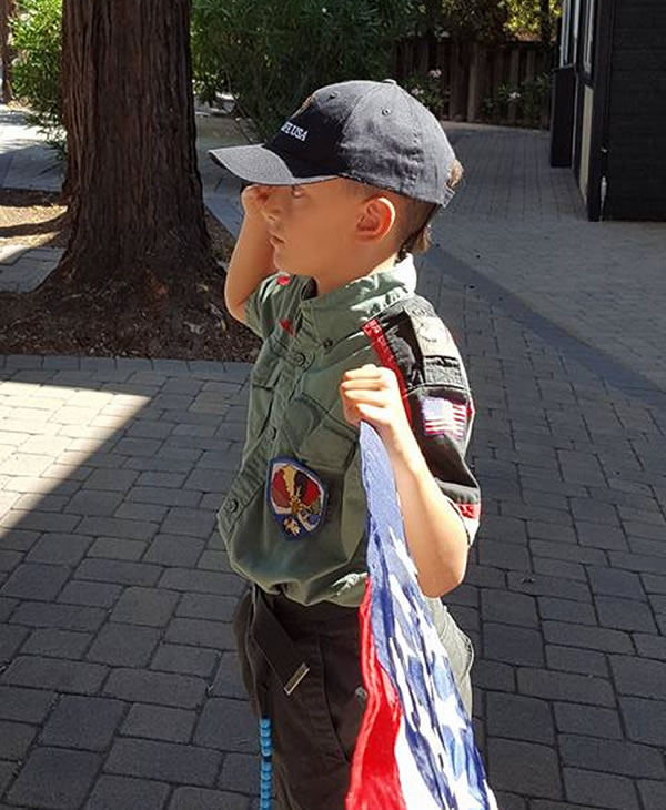 <div class='meta'><div class='origin-logo' data-origin='none'></div><span class='caption-text' data-credit='Photo submitted to KGO-TV by Melissa D./Facebook'>Melissa D. says her son Michael held his salute for almost 10 minutes as the procession drove by for fallen SJPD Ofc. Michael Katherman on Tues., June 21, 2016 in San Jose, Calif.</span></div>