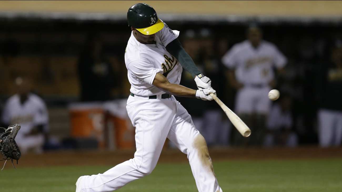 Oakland Athletics' Marcus Semien swings for a two run triple hit off Milwaukee Brewers' Blaine Boyer in the seventh inning Tuesday, June 21, 2016, in Oakland, Calif.