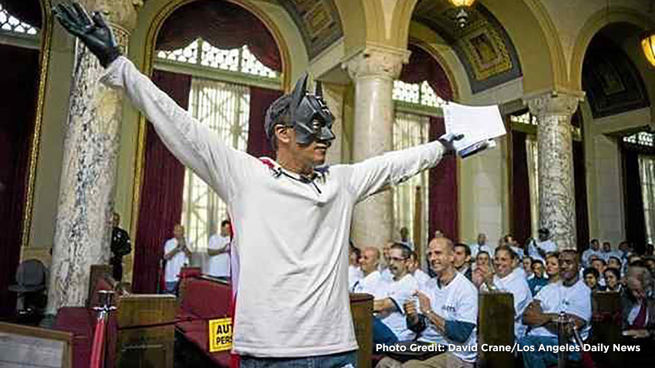 Armando Herman, dressed as Batman, speaks at a Los Angeles City Council meeting on Tuesday, July 29, 2014.
