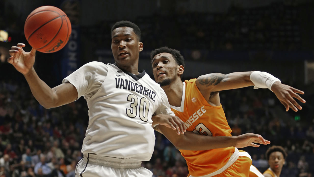 Vanderbilt's Damian Jones (30) and Tennessee's Derek Reese (23) battle for a rebound during the first half of an NCAA college basketball game Nashville, Tenn., March 10, 2016.