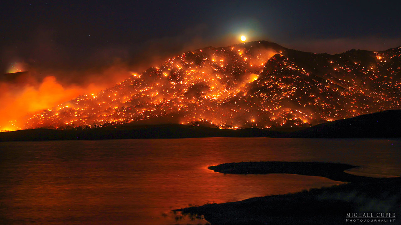 Images by photojournalist Michael Cuffe captured the beauty in the destructive power of the Erskine Fire in Kern County.