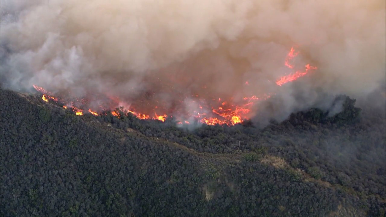 Flames rip through dry brush along the hillsides of the Gaviota coast in northern Santa Barbara County.