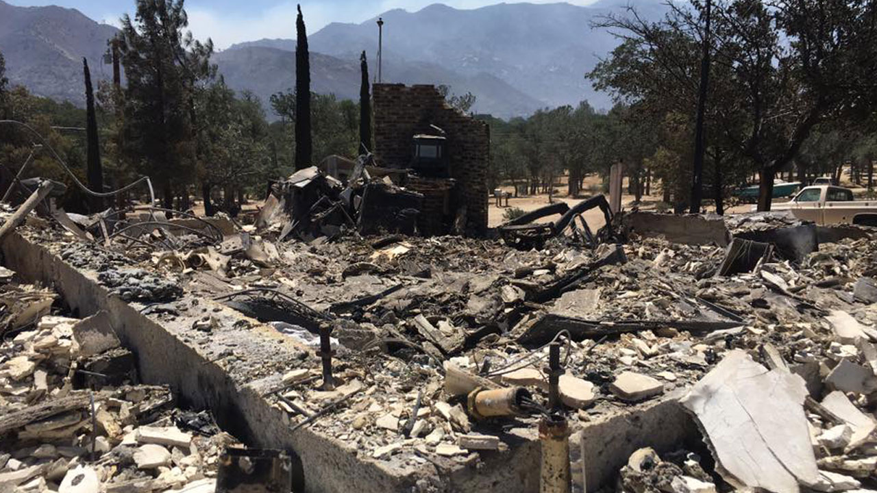 The rubble of a home destroyed by the massive Erskine Fire near Lake Isabella in Kern County is shown on Friday, June 24, 2016.