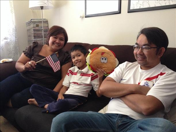 "<div class=""meta image-caption""><div class=""origin-logo origin-image ""><span></span></div><span class=""caption-text"">Family watches the USA vs. Portugal game.  Keep sending in your World Cup fan photos! (photo submitted via uReport)</span></div>"