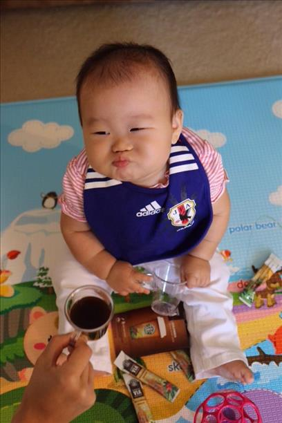 "<div class=""meta image-caption""><div class=""origin-logo origin-image ""><span></span></div><span class=""caption-text"">8-month-old Arisa, team Japan, reacts to the game vs. Colombia. Keep sending in your World Cup fan photos! (photo submitted by Madoka Hirao via uReport)</span></div>"