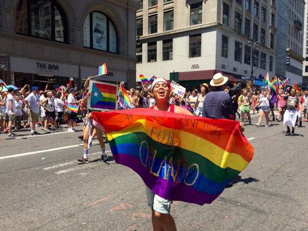 "<div class=""meta image-caption""><div class=""origin-logo origin-image none""><span>none</span></div><span class=""caption-text"">New York City's gay pride parade headed down Fifth Avenue Sunday, ending in Greenwich Village.</span></div>"