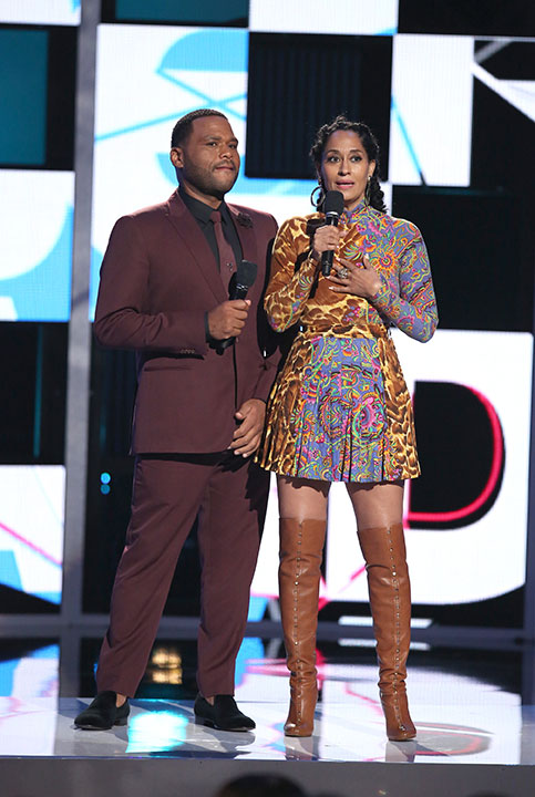 """<div class=""""meta image-caption""""><div class=""""origin-logo origin-image none""""><span>none</span></div><span class=""""caption-text"""">Hosts Anthony Anderson, left, and Tracee Ellis Ross speak at the BET Awards on Sunday in Los Angeles. (Matt Sayles/Invision/AP)</span></div>"""