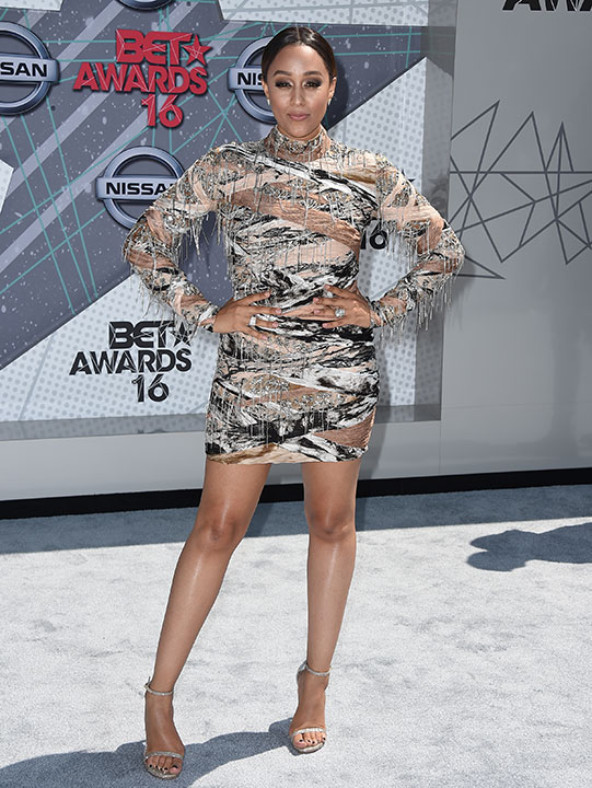 """<div class=""""meta image-caption""""><div class=""""origin-logo origin-image none""""><span>none</span></div><span class=""""caption-text"""">Tia Mowry arrives at the BET Awards on Sunday in Los Angeles. (Jordan Strauss/Invision/AP)</span></div>"""