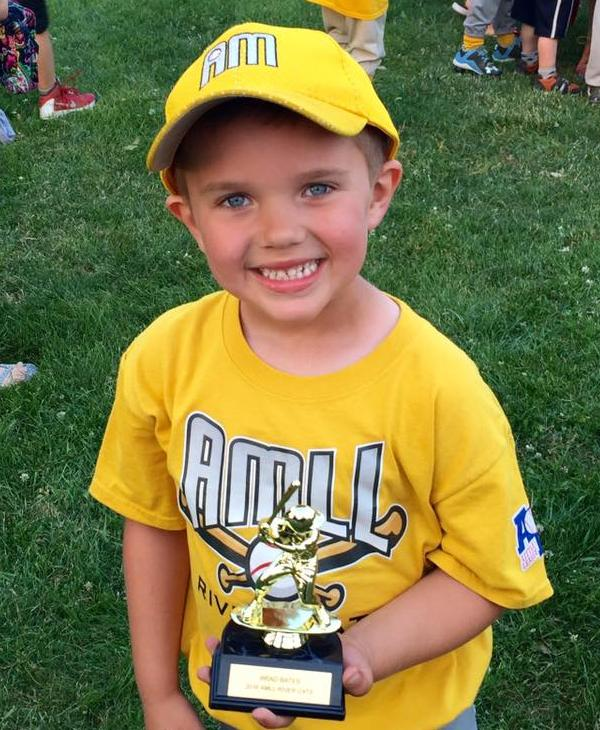 <div class='meta'><div class='origin-logo' data-origin='none'></div><span class='caption-text' data-credit=''>Congrats to Brad, who received his first tee-ball trophy!</span></div>